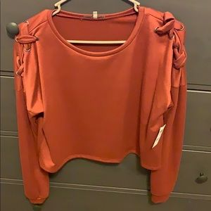 Cropped long sleeve sweater.